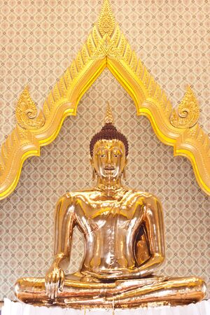Golden Buddha statue in Thailand photo