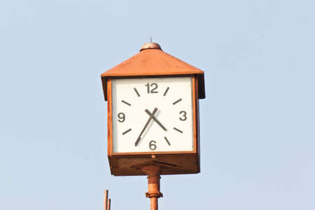 clock in garden photo