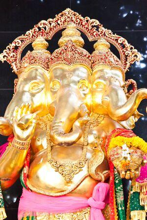 golden ganesh statue in thailand photo