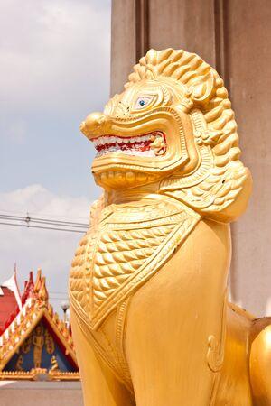 golden lion statue in thailand photo