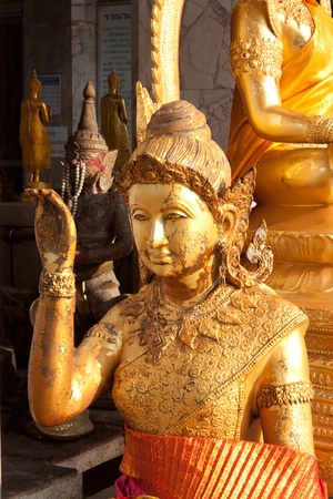 Woman statue beckoning happy lot statue in thailand photo