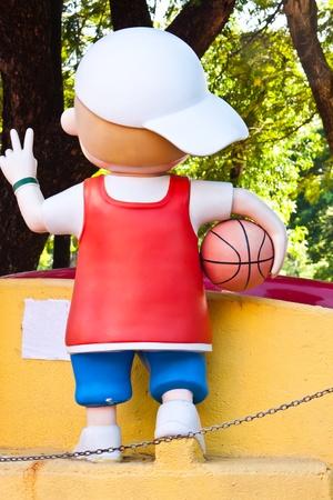 basketballs: Statues of children holding basketballs