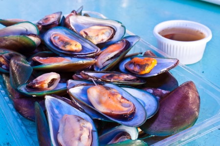 Steamed clams with a delicious sauce photo