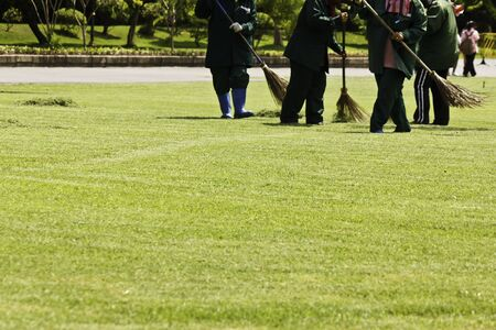 The gardener was sweeping grass photo