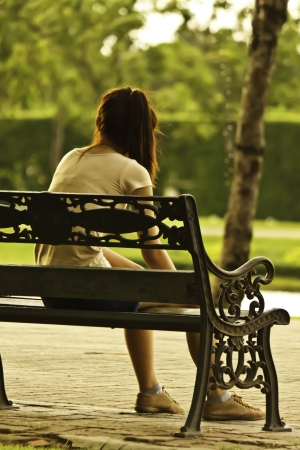alone lady in garden Stock Photo