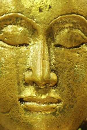 face of Buddha statue in thailand photo