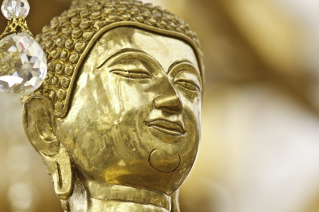face of Buddha statue in thailand Stock Photo