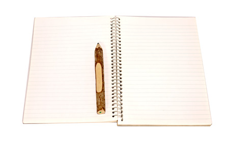 notebook on white paper photo