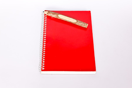 notebook and pencil on paper photo