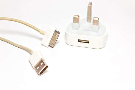 plug and cable on white paper photo