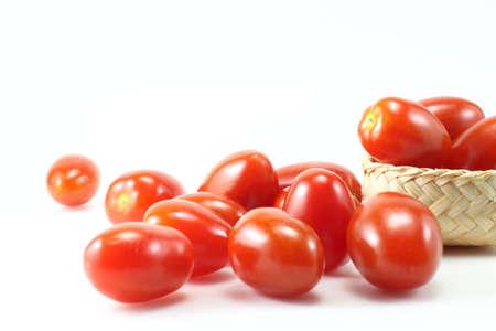 tomato in basket on white background