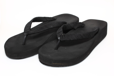 black slipper on white background photo
