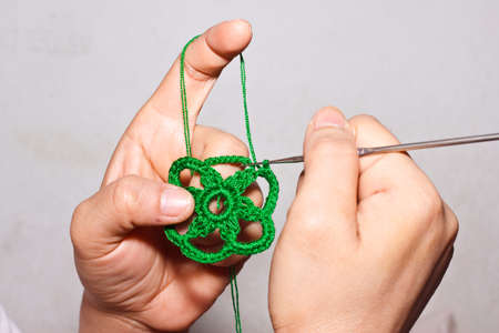 string together: the knitting work Stock Photo