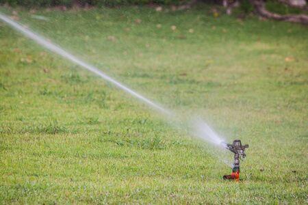 sprinkle system: the sprinkler in garden