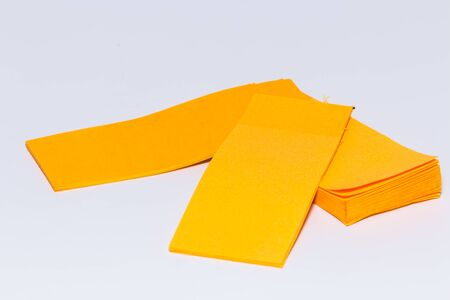 yellow tacks: orange paper on white background