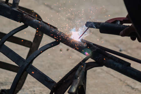sparks: Sparks from welding work Stock Photo