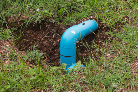 sump: water pipe in pit Stock Photo