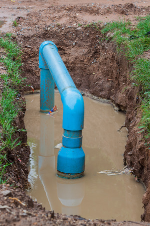 water pipe in pit Stock Photo