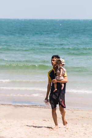farther: PRACHUAP KHIRI KHAN, THAILAND - FEBRUARY 11: Father hold baby on February 11, 2017 at Hua Hin Beach, in Prachuap Khiri Khan , Thailand Editorial
