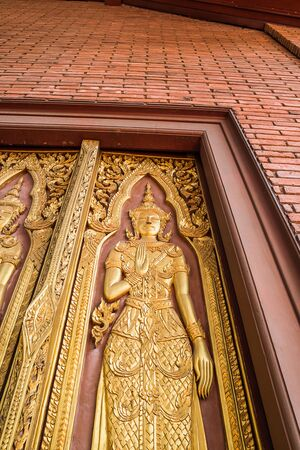 golden angel statue on big door at temple in Ayutthaya Province ,Thailand Stock Photo