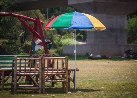 colorful umbrella with bench