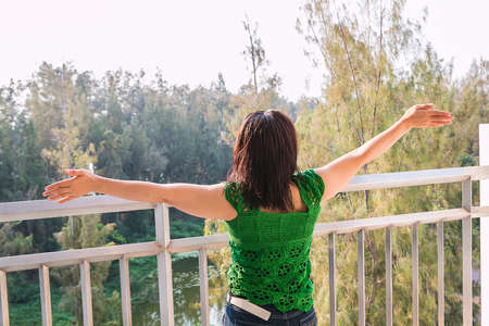 one lady at balcony Stock Photo