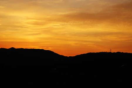 orange sunset over the mountains and a power transmition tower, Guri-si, Korea Stock Photo - 16468726