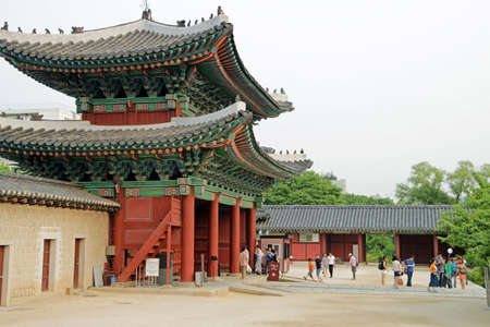 people's cultural palace: tourists and front gate of Changgyeonggung Palace in Seoul, Korea Editorial