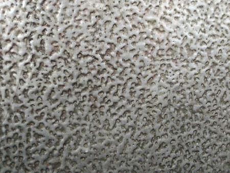 Light grey rough plastic surface texture background.