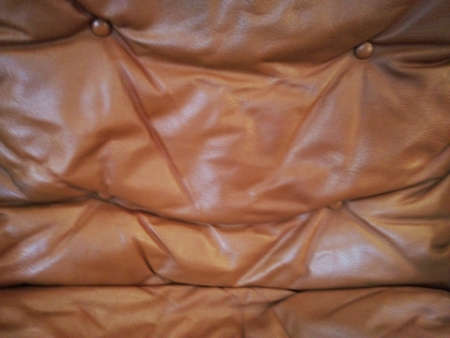 Brown leather with round buttons background.