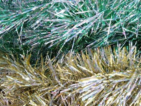 Artificial sparkling green and gold pine tree macro for Christmas decoration