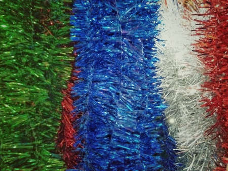 Artificial sparkling red green blue and white pine tree macro for Christmas decoration 스톡 콘텐츠