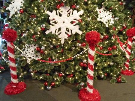 green pine tree with white snowflakes decor.