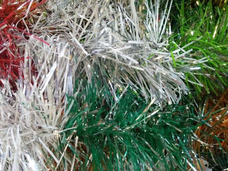 Artificial sparkling red green orange and white pine tree macro for Christmas decoration 免版税图像