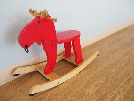 playtime: Red rocking horse Stock Photo