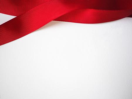 ribbin: Red ribbon on white paper for background