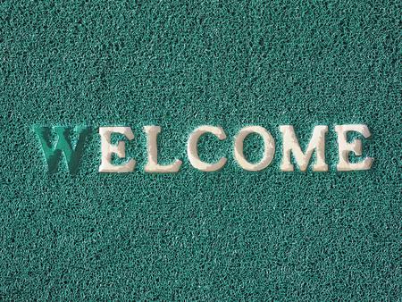 doormat: Welcome text on green doormat Stock Photo