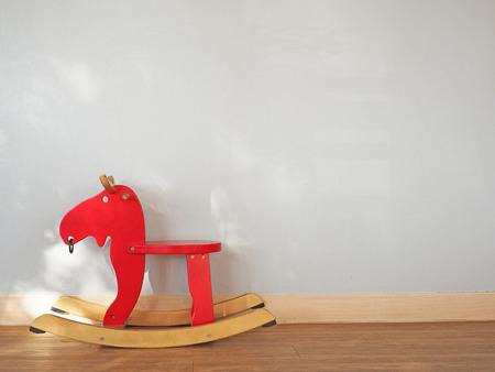 wean: Baby rocking horse on wooden floor