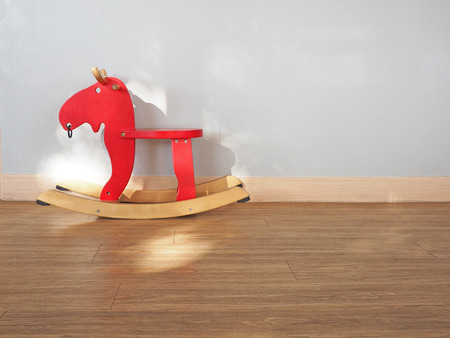kiddy: Baby rocking horse on wooden floor