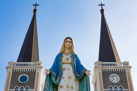 Blessed virgin mary statue in front of catholic church