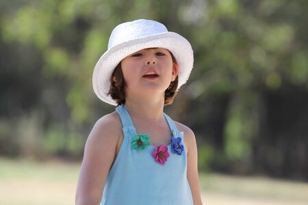 Pretty young girl in white hat Stock Photo - 15626401
