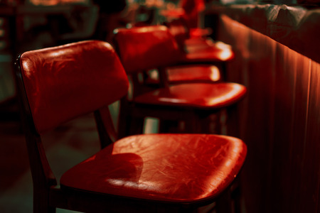 Empty red bar stool in an empty restaurant Banque d'images