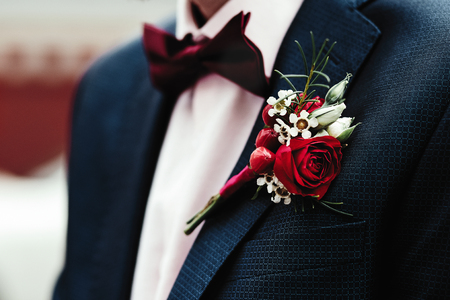 Grooms boutonniere on the jacket red red rose