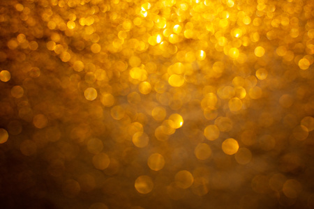 Gold glitter background with bokeh defocused orange lights Imagens