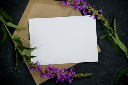 Minimal composition with envelope with purple flowers Reklamní fotografie
