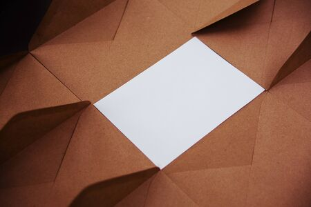 Blank white card with kraft brown paper envelope