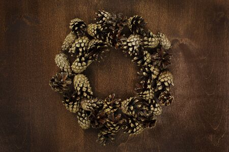 Pine cones on old wooden table flat lay