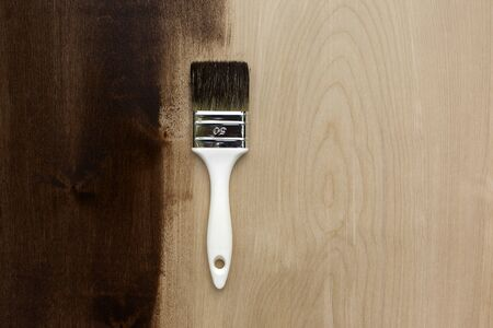 Fresh painted wooden board, renovation concept. Top view. Reklamní fotografie