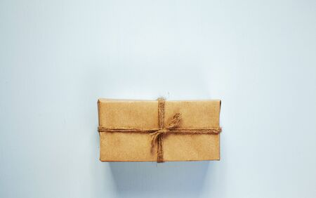 Gift box with ribbon on blue wooden background Stock Photo