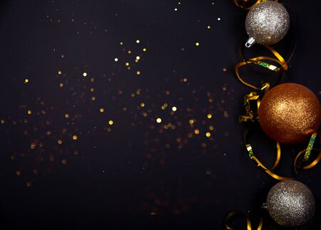 New Year bright balls on black background, Christmas background, new year concept 2020 Stock Photo
